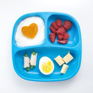 toddler lunch recipe - cheddar cheese, egg, green bean and turkey roll-ups, pumpkin yogurt and chopped raspberries