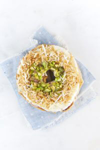 toasted coconut and pistachios on a bagel